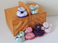 handcrafted round pin cushion sets with button feature