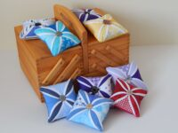 handcrafted stained glass effect pin cushions with button feature