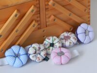 Handcrafted wrist pin cushions with button feature