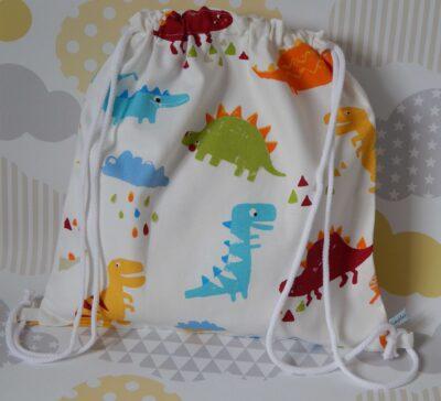 backpack style showerproof bag dinosaurs