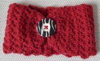 handknitted red earwarmers