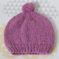 child's pull on hat with pompom